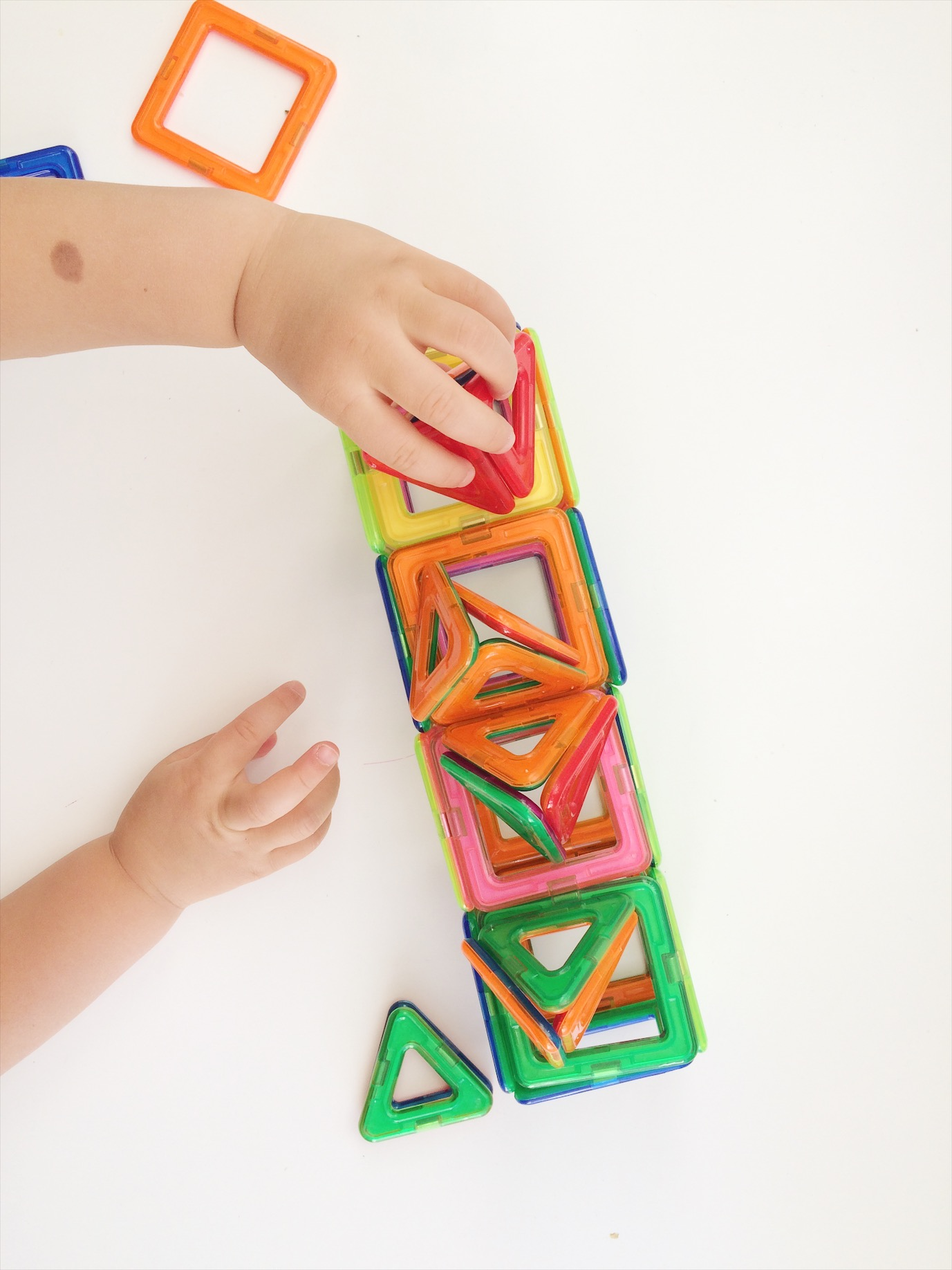 Toddler making house with magnetic building blocks