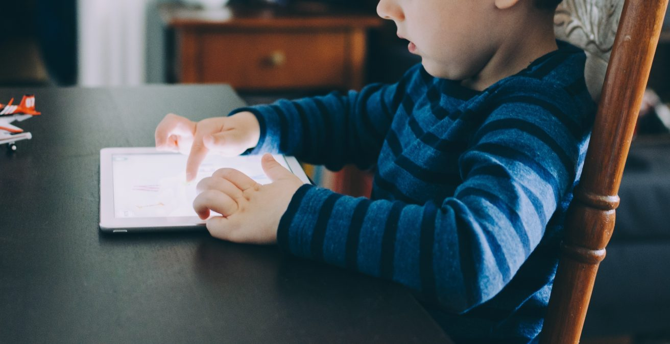 Little boy zoned out on tablet
