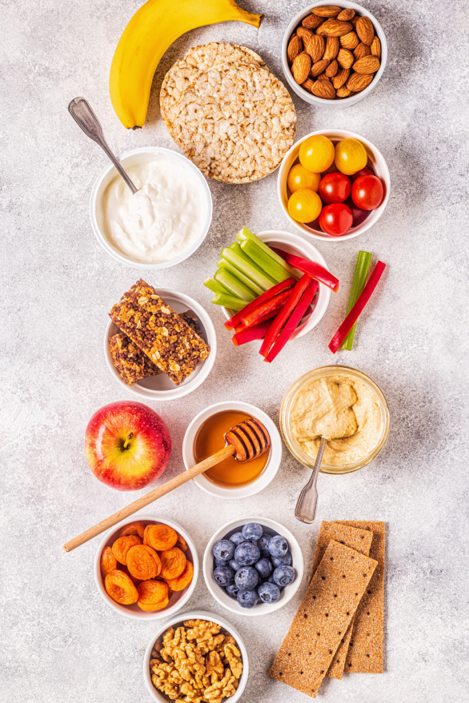 Healthy Snacks of fruit and nuts taken from a bird's eye view on a white background