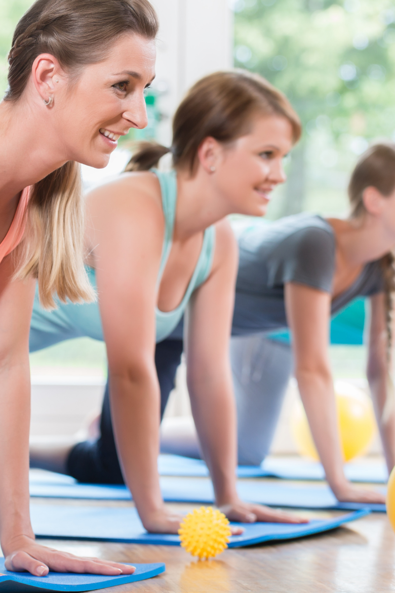 Moms in a workout class, how to successfully lose postpartum weight without making these mistakes